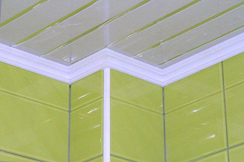 Виды плинтусов для натяжного потолка - Пластиковый карниз