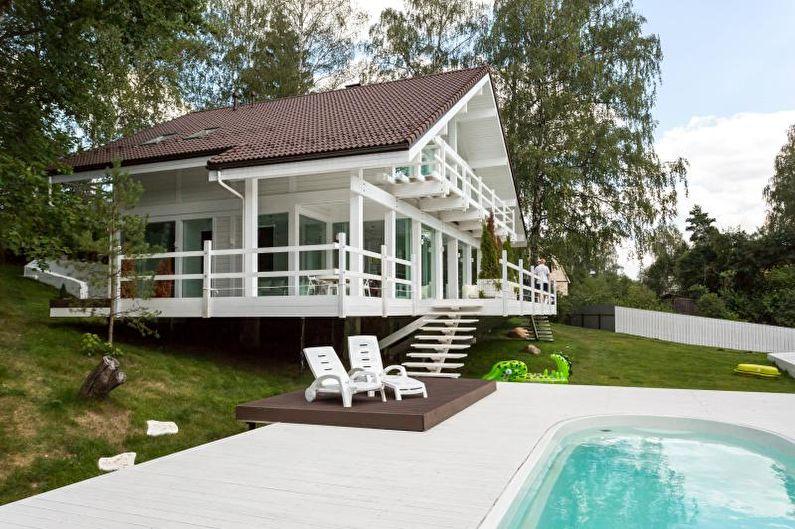 Белый загородный дом в скандинавском стиле - фото