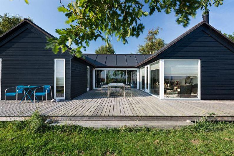 Черный загородный дом в скандинавском стиле - фото