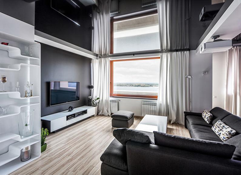 Черный глянцевый натяжной потолок в зале (гостиной) - фото