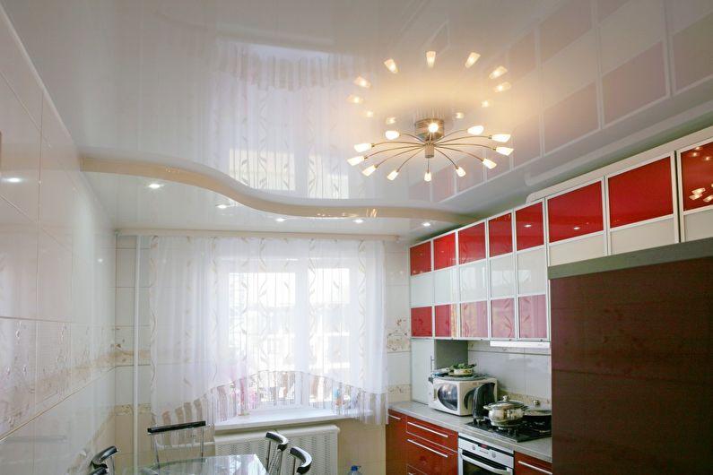 Белый глянцевый натяжной потолок на кухне - фото