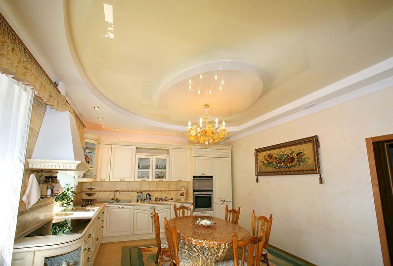 Бежевый глянцевый натяжной потолок на кухне - фото