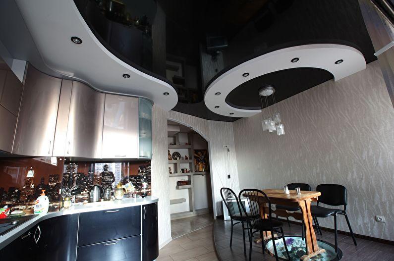 Двухуровневый натяжной потолок на кухне - фото