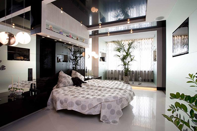 Черный глянцевый натяжной потолок в спальне - фото