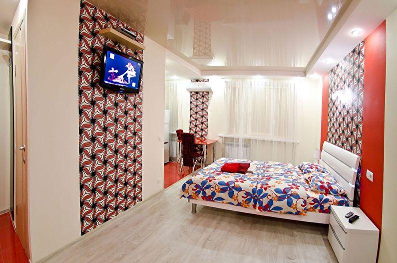 Глянцевый натяжной потолок в спальне - фото