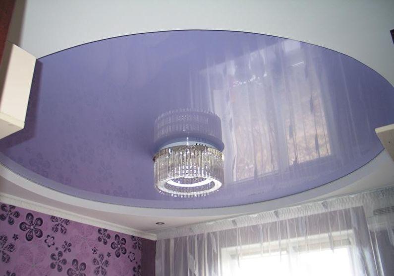 Двухуровневый натяжной потолок в спальне - фото