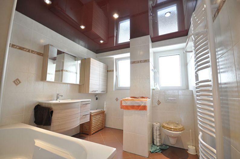 Коричневый натяжной потолок в ванной - фото