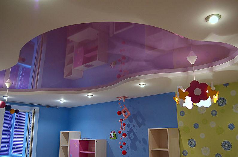Двухуровневый натяжной потолок в детской комнате - фото