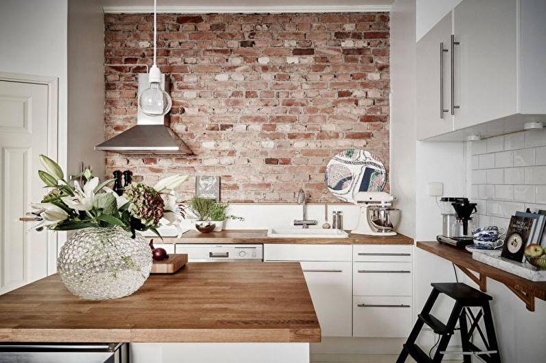 Кирпичная стена в интерьере кухни - фото