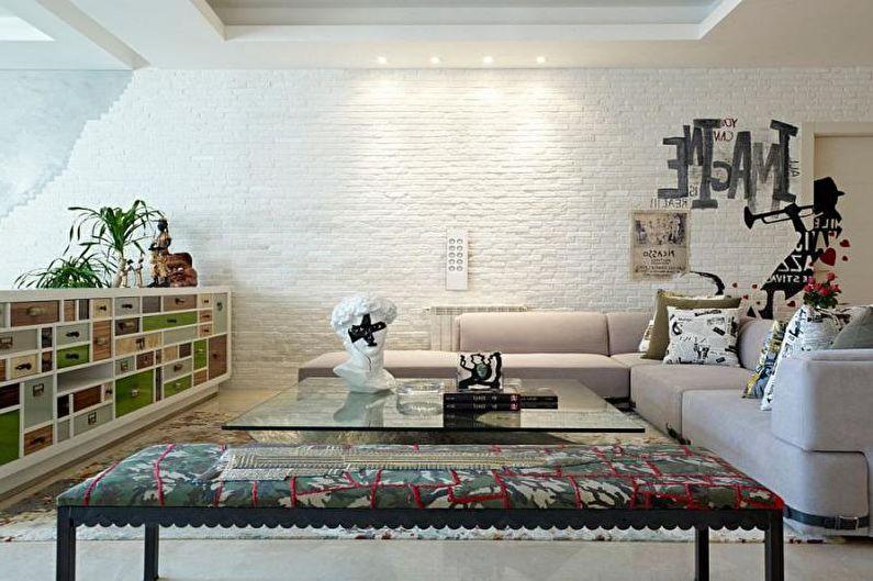 Кирпичная стена в интерьере гостиной - фото