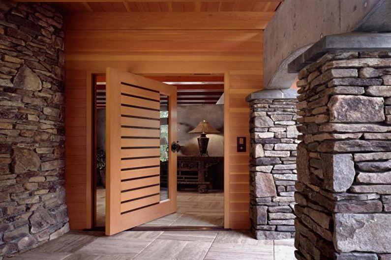 Декоративный камень в интерьере прихожей - фото