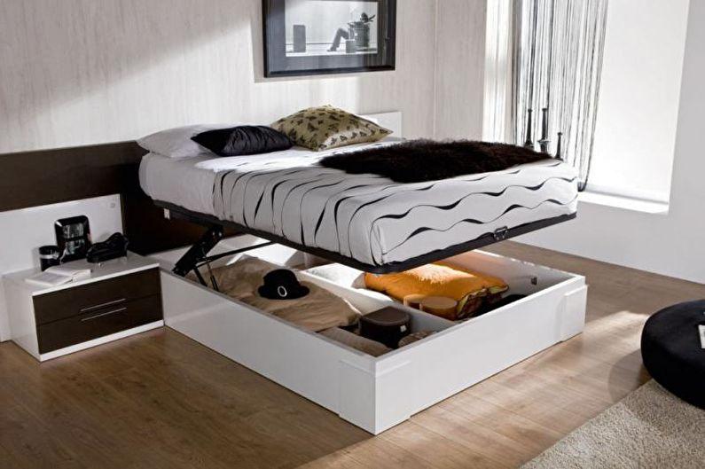 Дизайн однокомнатной квартиры 33 кв.м. - Кровать с коробом вместо ножек