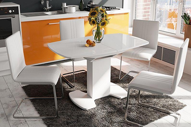 Обеденный стол с одной ножкой