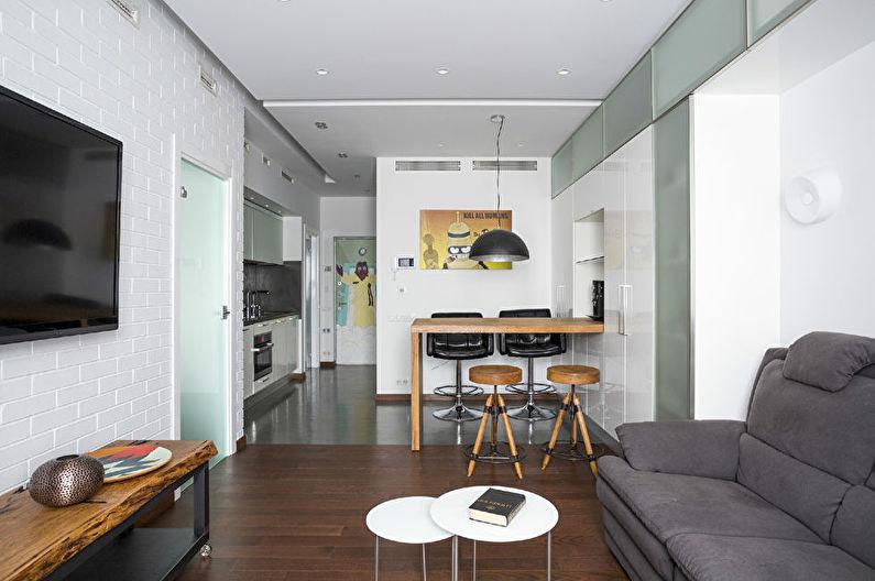 Дизайн интерьера кухни-гостиной в белом цвете - фото