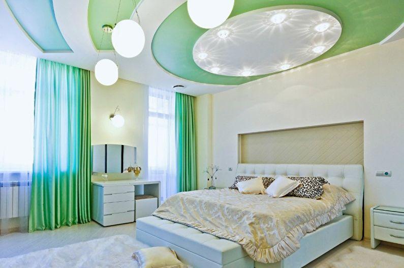 Зеленые натяжные потолки в спальне - фото