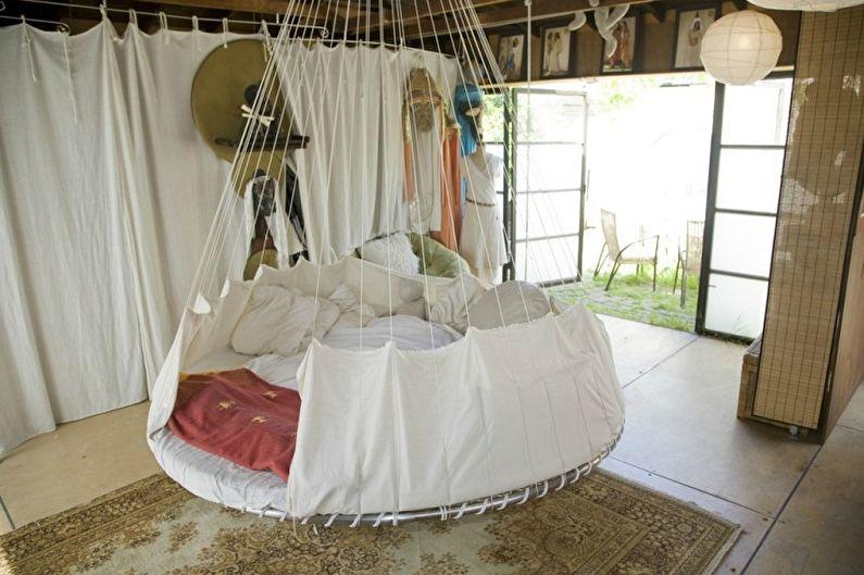 Виды круглых кроватей в спальню - Подвесная кровать