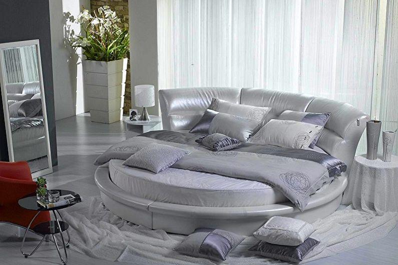 Круглая кровать в спальне - фото