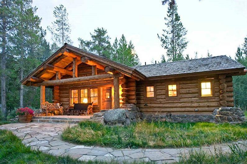Современные проекты домов из сруба - Охотничий домик из оцилиндрованного бревна