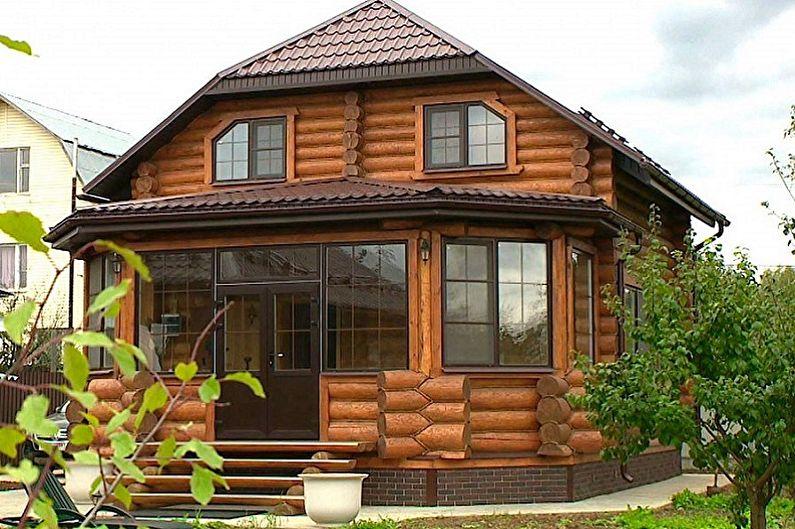 Современные проекты домов из сруба - Бревенчатый дом с верандой