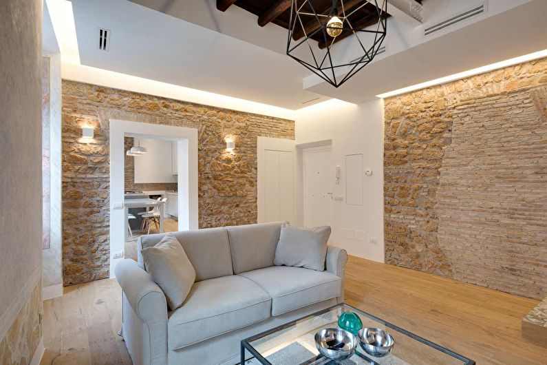 Декоративный камень в интерьере гостиной - фото
