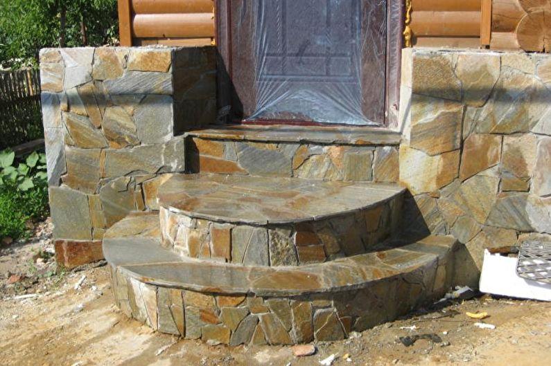 Оформление крыльца из камня для частного дома - фото