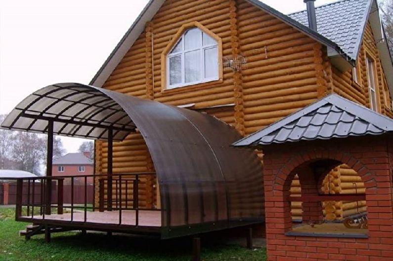 Оформление крыльца с навесом для частного дома - фото